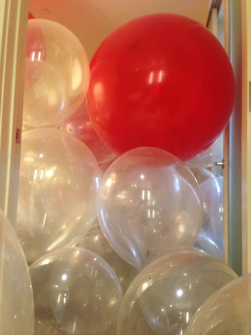 Room full of balloons, prepared by Victoria's devoted sub.
