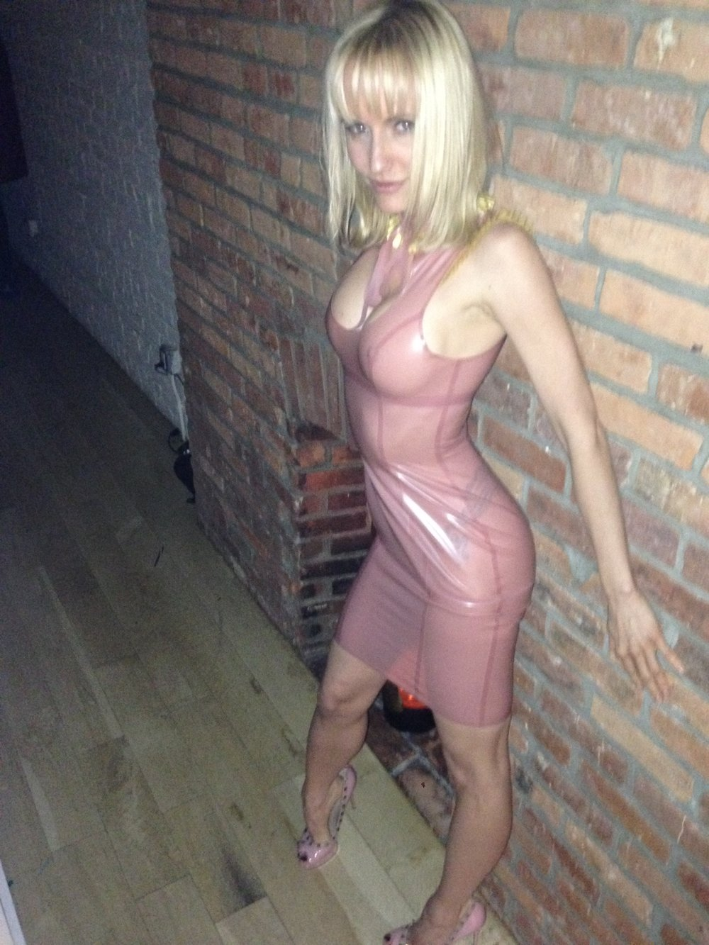 Victoria in a pink Syren latex dress and Valentino shoes.
