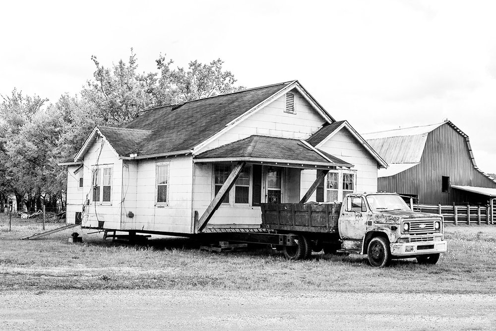 Truck towing a house, White Haven, Tennessee, TN, United States by Leica Photographer Manuel Guerzoni