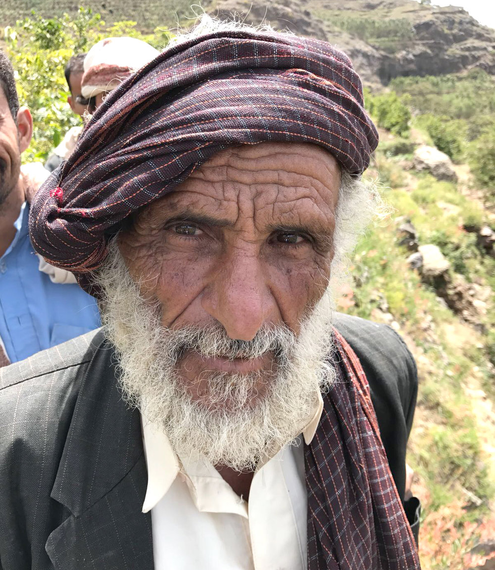A Case Study: Hajji Mubarak - Hajji Mubarak is a farmer from the renowned Al-Ruwad coffee cooperative perched in a lush mountain valley 2300m above sea level. His family has been in coffee for generations going back at least 400 years. During our visits to his village, he frequently showed us coffee trees that dated back more than 200 years! Hajji Mubarak treats his trees as he does his own family, and insists that coffee buyers should receive his coffee with the very same love and attention. Hajji Mubarak's ChallengesAs with many smallholder farmers, and especially in the case of Yemeni farmers, Hajji Mubarak's principal concern centers around cash flow. He loves coffee and has the ideas and the passion to improve his production exponentially, yet he lacks the financial resources to either implement his ideas nor even meet his basic living needs. In the immediate term, Hajji Mubarak needs cash. In the short term, he needs training to help him produce quality coffee along with attractive prices to support his financial independence and to invest in his farm. In the medium and long term he needs a platform and a partnership to help him and his future generations sustainably produce some of Yemen's best coffee.