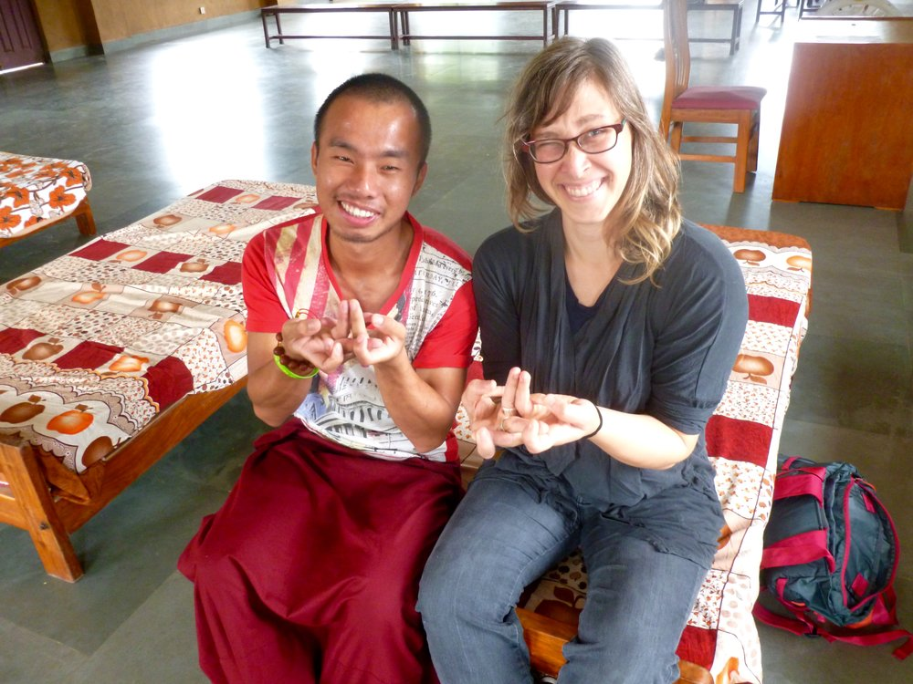 Learning some hand mudras from Sangye!