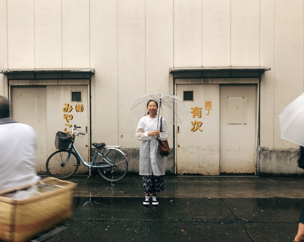 Me in the rain at the Tsukiji fish market in Tokyo.