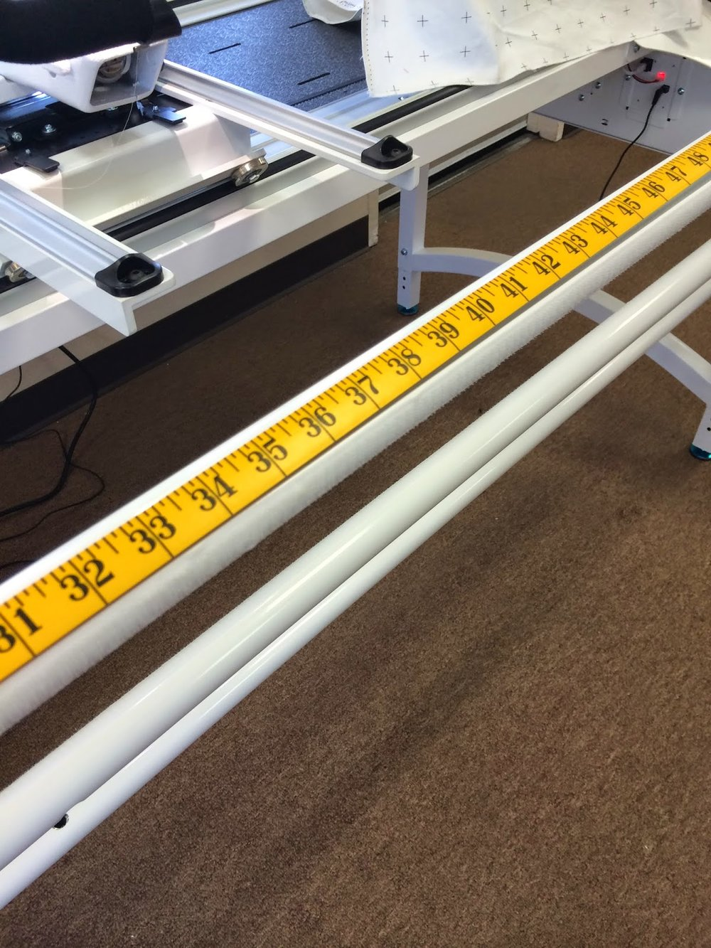 You may need a friend for this step.  They can help you hold the tape measure.  Or you can hold in place with painters tape.  Measure each frame rail.  Mark center.  We used blue painters tape on the store frame.  At home I used a fine line Sharpie red marker.