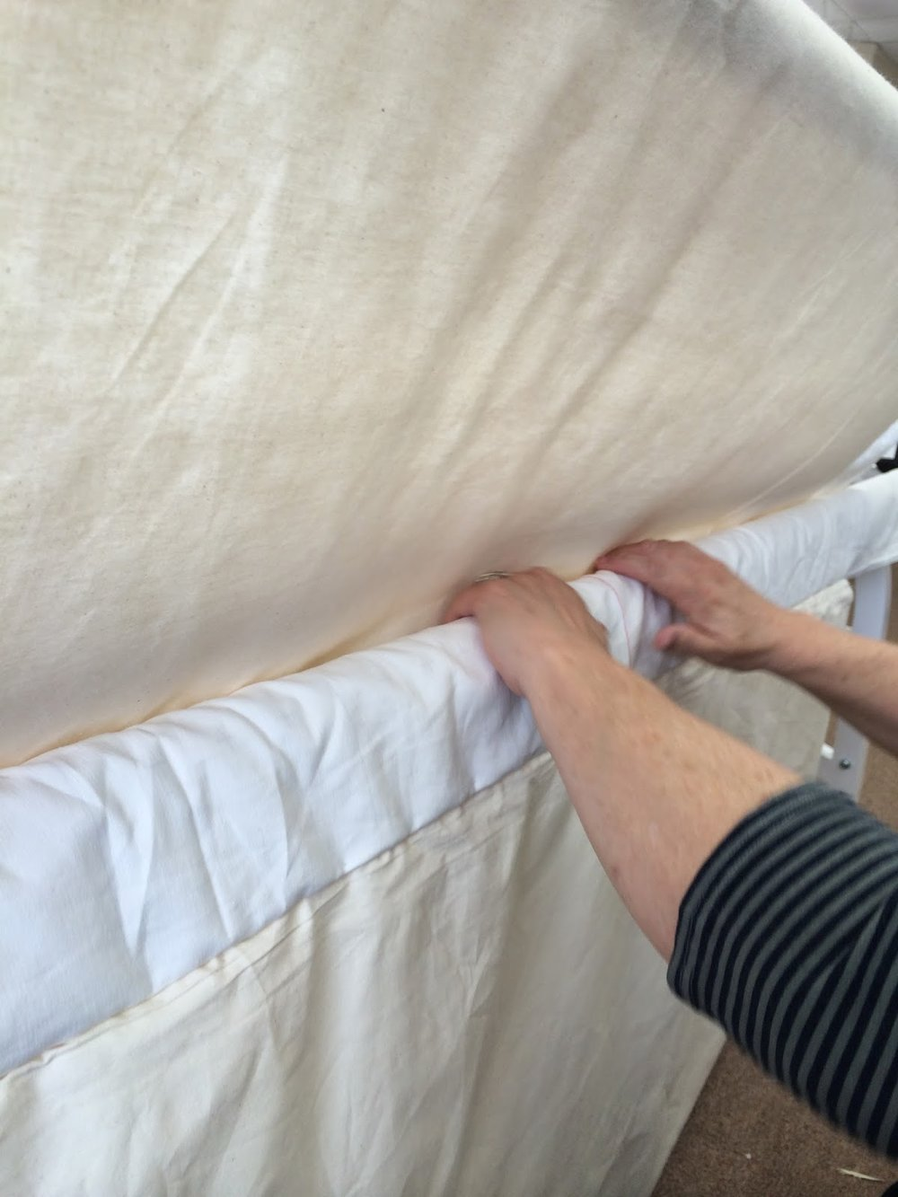 Baste the top of the quilt to the backing and batting. Repeat pinning to the leaders with the top of the quilt.