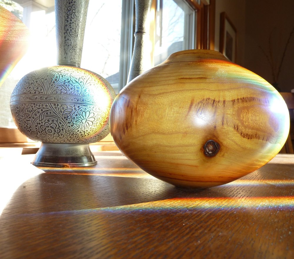 I enjoy turning especially given its call for fluid design and practice of the hand. - A vessel by Mike Jackofsky — with whom I studied for a week — on a table purchased in honor of my uncle Harvey, a real craftsperson.