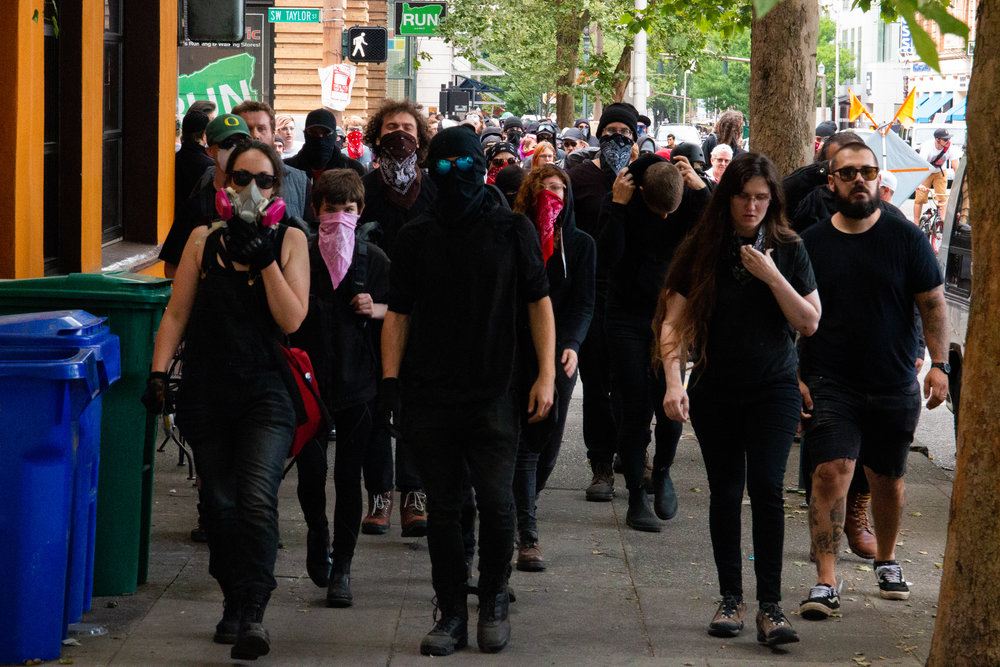 Antifa activists march to intercept Proud Boys