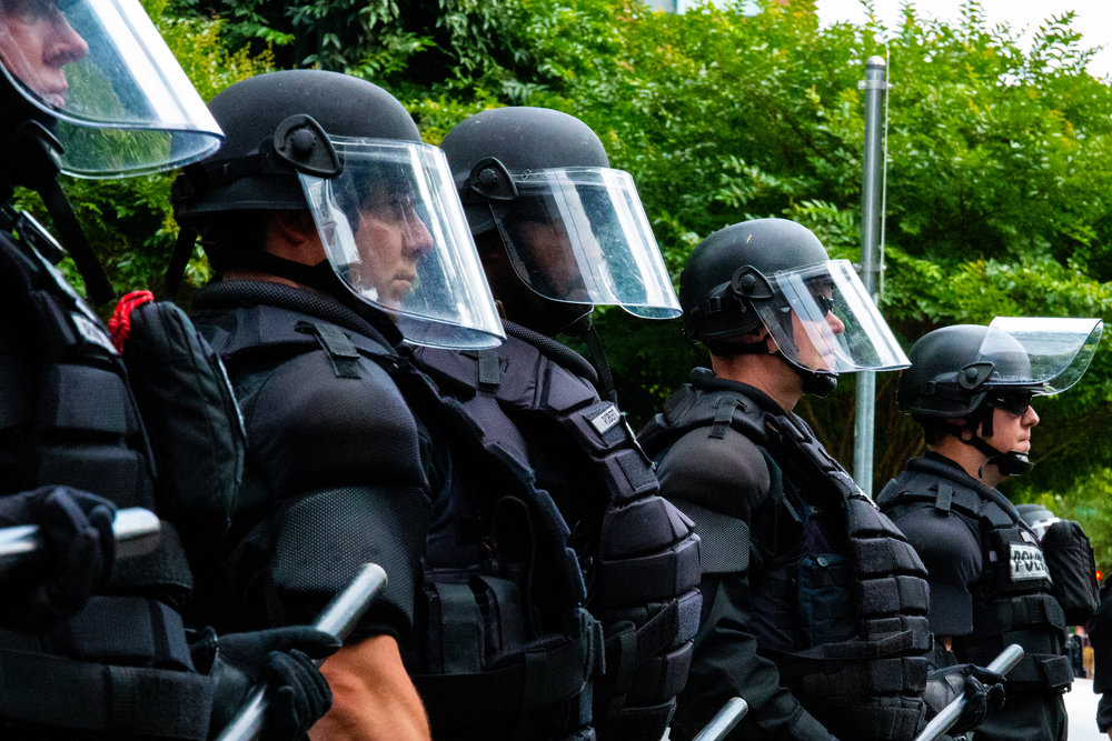Portland police form a line in riot gear