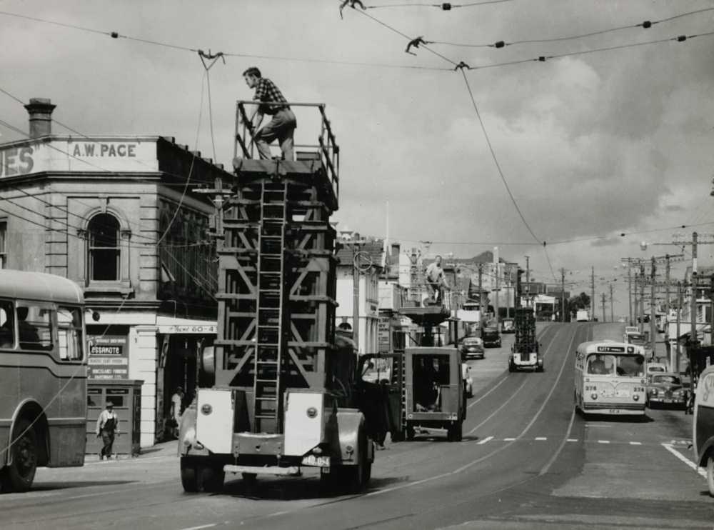 TRAMS REMOVED: Overhead tram wires removed in Kingsland in 1956 (Photo: Sir George Grey Special Collections, Auckland Libraries, 255A-55)