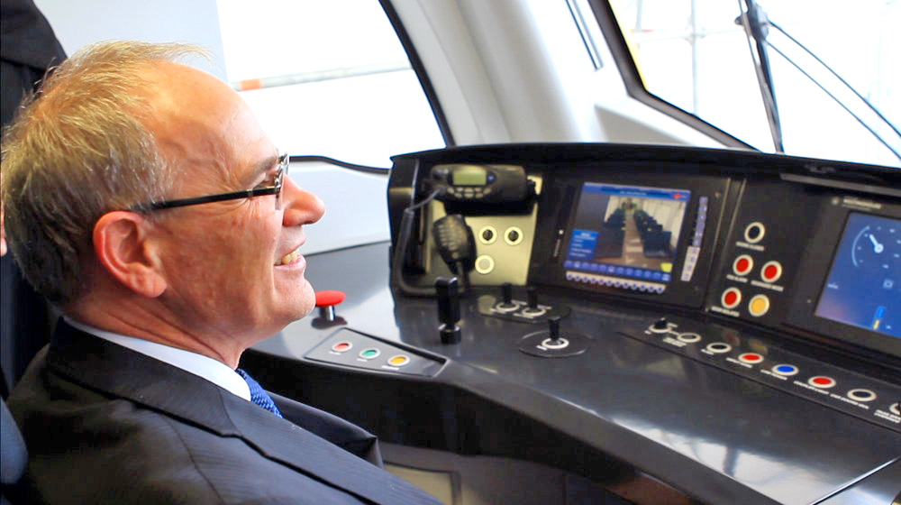 GETTING THE CITY MOVING: Former Auckland Mayor Len Brown tries out a new electric train