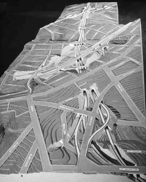 MOTORWAY PLAN: This model of the proposed motorway interchange over Newton Gully was being displayed in the late 1950s (Photo: Sir George Grey Special Collections, Auckland Libraries, 580-3916)