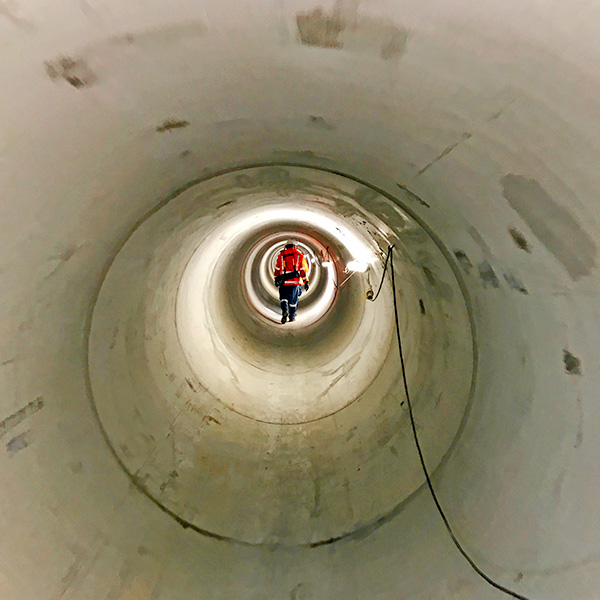 INSPECTION: Workers inspect the shaft at the end of the new stormwater shaft under Wellesley Street