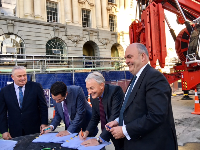 AGREEMENT: Signing the agreements Deputy Mayor Bill Cashmore, Transport Minister Simon Bridges, Mayor Phil Goff and Finance Minister Steven Joyce at the Britomart construction site