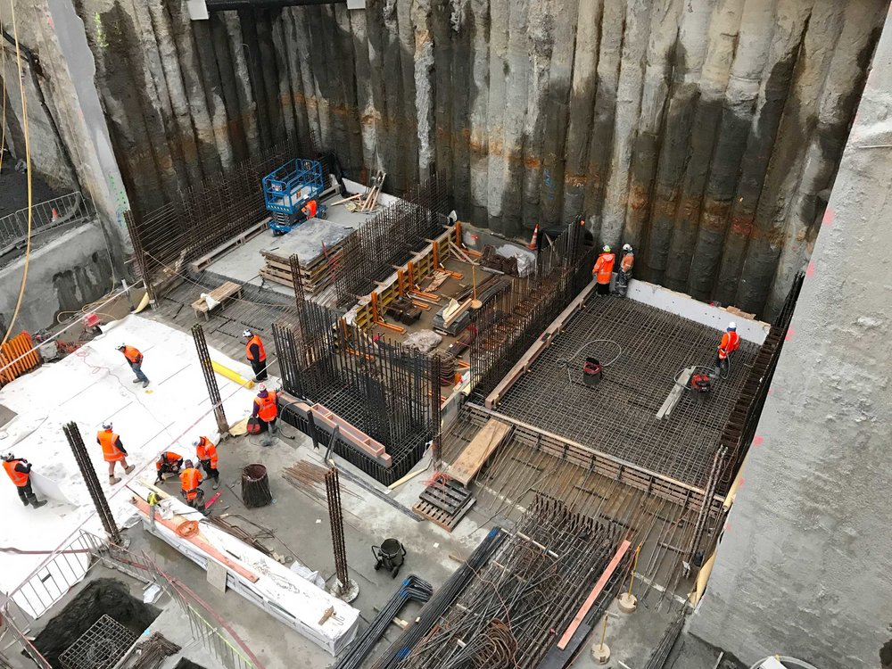 CONCRETE: This is looking down the neighbouring Precinct Commercial Bay Fletcher Construction project where the first concrete slab base has appeared.  The foundations for the 39-level tower on the former site of the Downtown mall are being dug concurrently with the beginning of the CRL tunnels