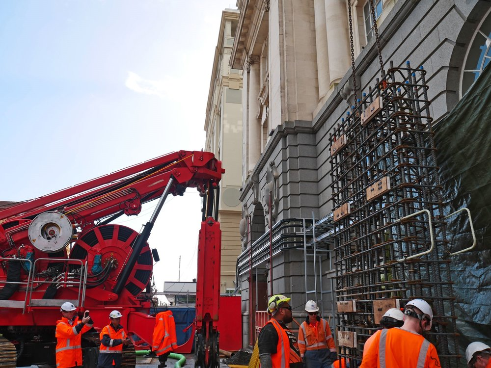 CRL construction work in Lower Queen Street.  This bright red 90 tonne piling rig named Sandrine worked inside and outside the historic Chief Post Office (Britomart Transport Centre) building until being returned to France in early 2018.