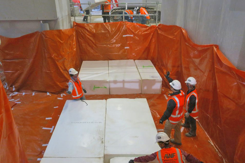 STACKED: Blocks are stacked three-layers high from B1 to the height of the temporary floor and a concrete slab is poured on the top