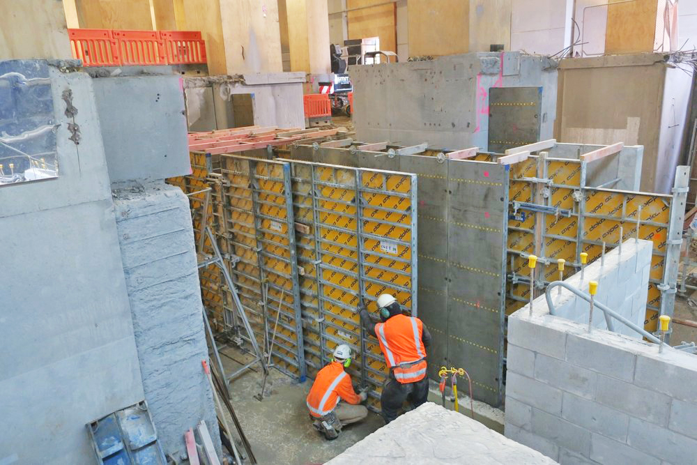 BOXED: Slots for the guide walls are cut on the B1 level,then they are built up to a temporary floor level and boxed for the concrete and filler pour
