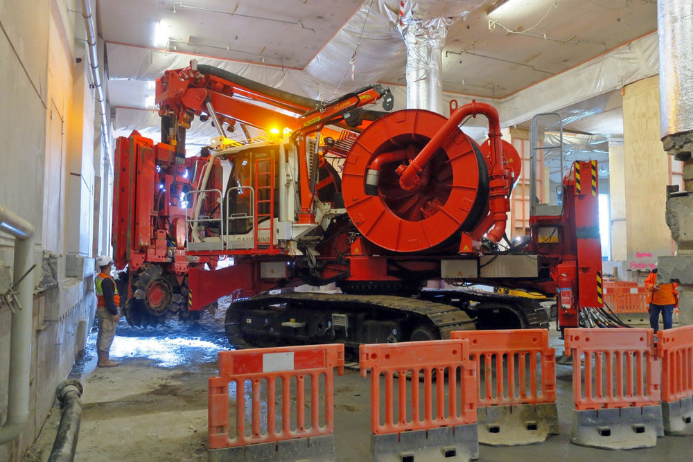 This bright red 90 tonne piling rig named Sandrine worked inside and outside the historic Chief Post Office (Britomart Transport Centre) building until being returned to France in early 2018. This is Sandrine inside the building September 2017.