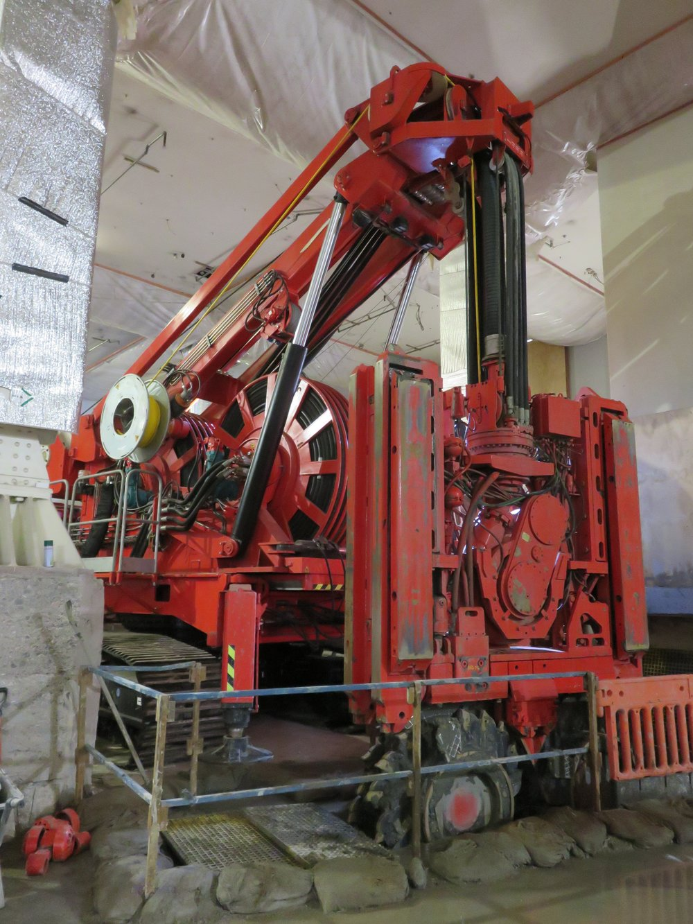 This bright red 90 tonne piling rig named Sandrine worked inside and outside the historic Chief Post Office (Britomart Transport Centre) building until being returned to France in early 2018. This is Sandrine working inside the CPO September 2017