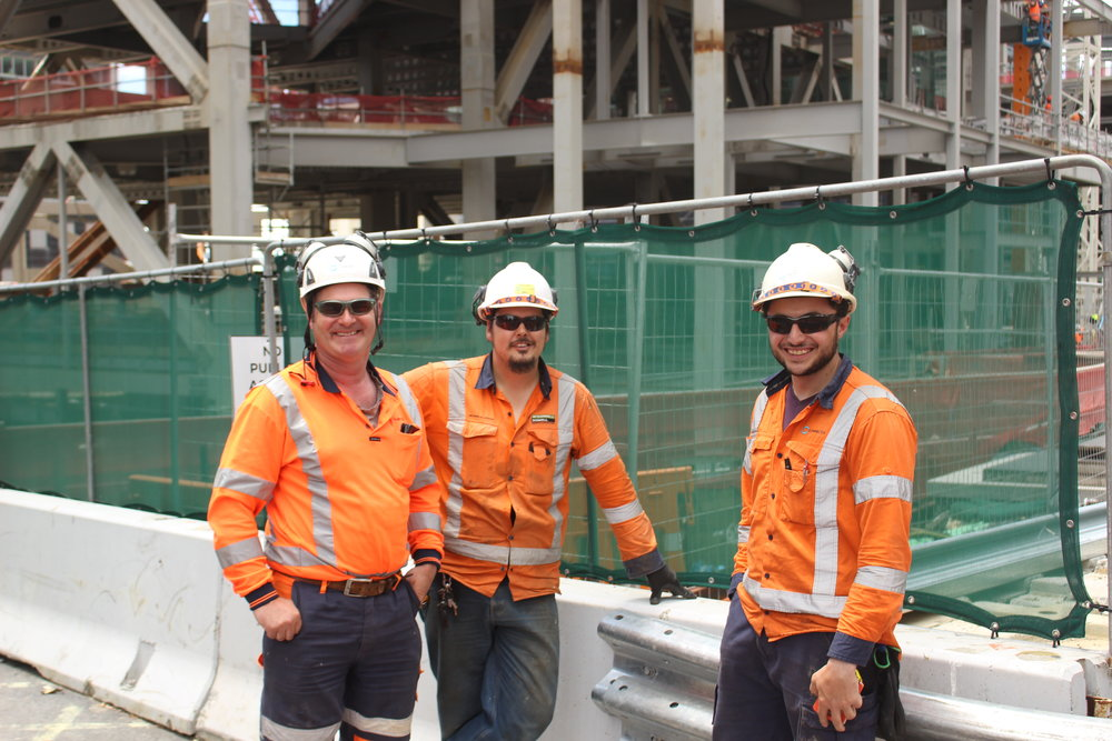 TEAM WORK: Three of the team that constructed Albert Street's City Rail Link concrete slab road, from left: Steve McLaughlin (Connectus supervisor), Joseph Stanaway (Connectus Leading Hand), and Aaron Ghazal (Connectus site engineer)