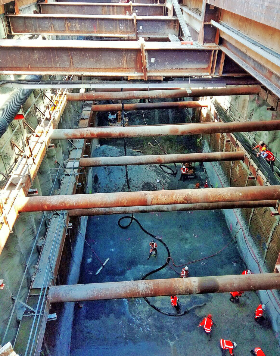 POUR:The CRL construction team pouring the concrete at the bottom of the future rail tunnels