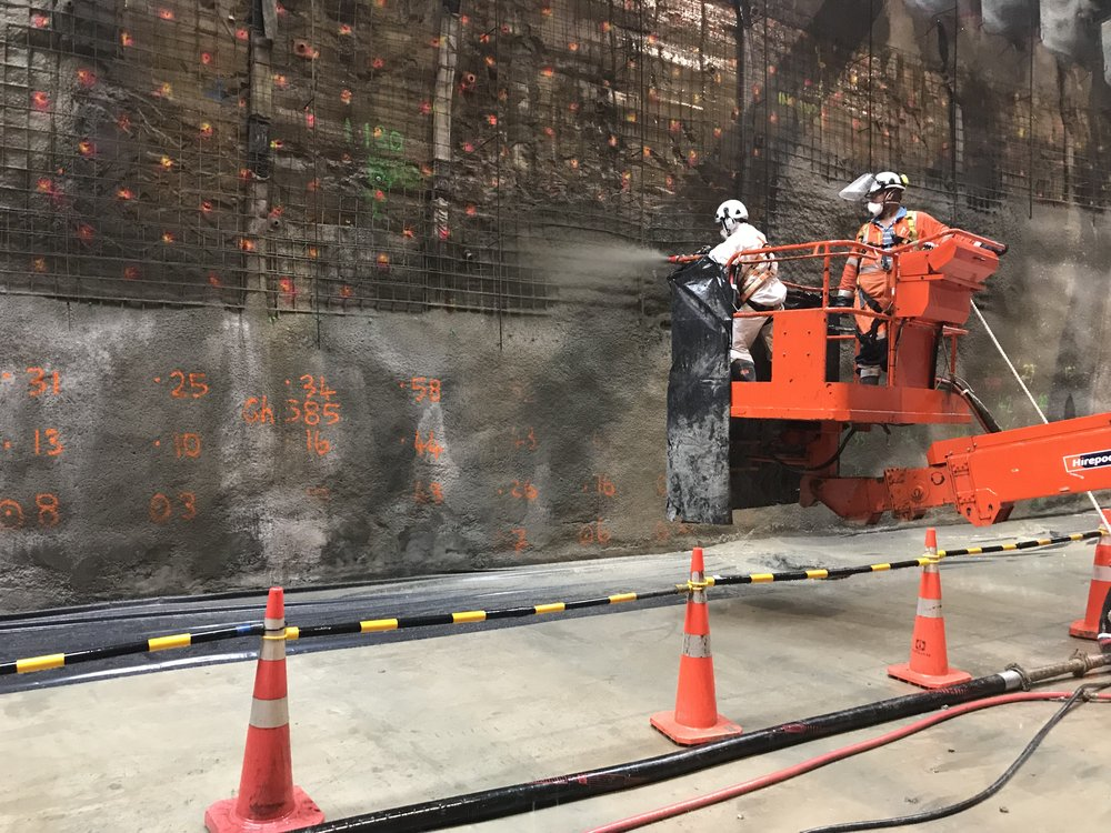 PREPARATION: Alan Phillips (Connectus Tunnel Manager) spraying the wall. Viliame Delavakavu (Connectus Operator) is driving