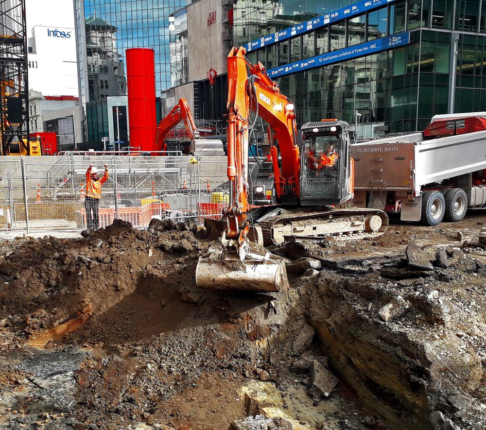 Excavating trench in Lower Queen Street