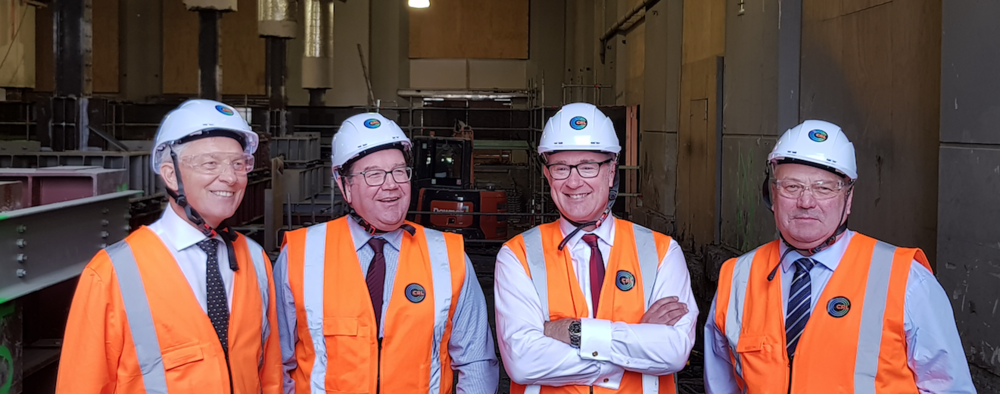 Mayor of Auckland Phil Goff, Minister of Finance Hon. Grant Robertson, Transport Minister Hon. Phil Twyford and Deputy Mayor Bill Cashmore inspect the CRL construction inside the Chief Post Office building