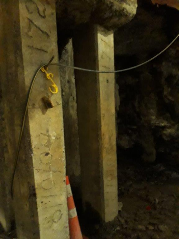 Excavation work in July 2018 exposed the existing foundations of Britomart's 106-year-old Chief Post Office (CPO) building.  Records are being taken for heritage and posterity reasons before the old foundations are removed and the excavation progresses deeper underground.  The CPO building is now being supported by a new underpinning structure on new foundations.  In August 2018, while excavating the northern trench, contractors Downer NZ and Soletanche Bachy JV found an old pile dated 08/10/1909