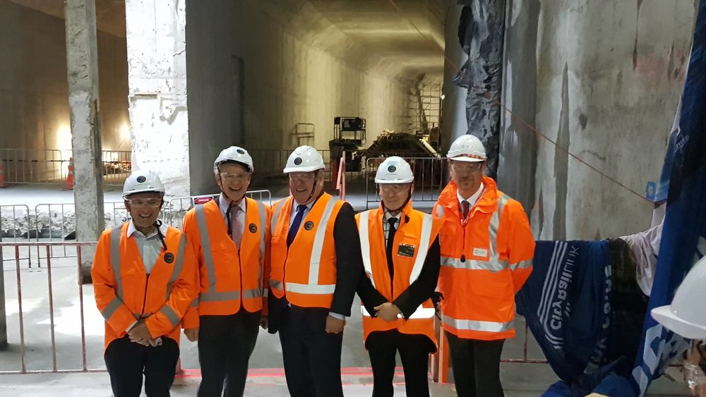 City Rail Link (CRL) celebrating a major milestone with the breakthrough to the Commercial Bay development site from the Albert Street trench tunnels – in downtown Auckland. From left - City Rail Link Chair Sir Brian Roche, Auckland Mayor Phil Goff, Deputy Auckland Mayor Bill Cashmore, CRL CEO Dr Sean Sweeney and Executive General Manager Infrastructure Projects Downer New Zealand John Burden . 5 December 2018