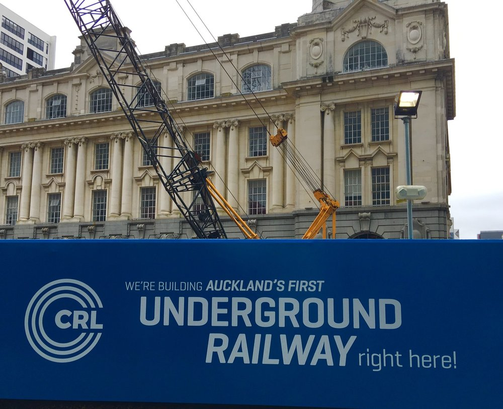 Hoarding in front of Chief Post Office building Auckland reading We're building Auckland's first Underground Railway here