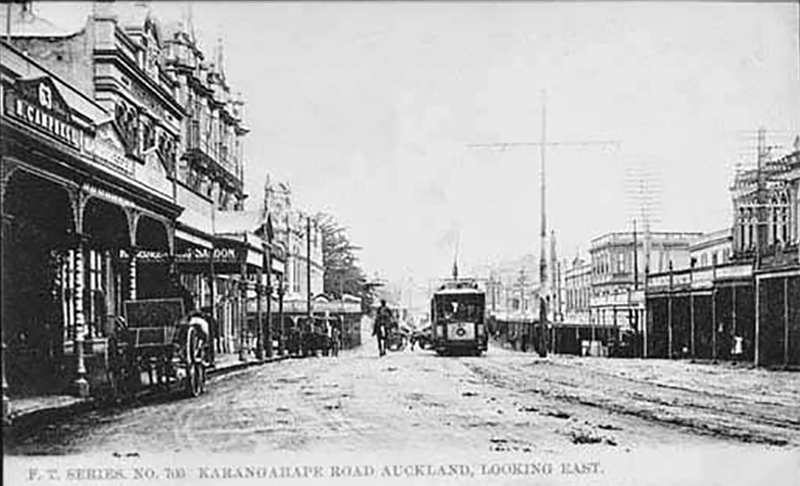 TRAMS ARRIVE: This is how the street looked in 1906 - looking east along Karangahape Road, towards Pitt Street. Showing the premises of Mrs R Campbell, ladies outfitter, W F Jamieson, hairdresser, Foresters Hall, Naval and Family Hotel, Tatterfield and Company, importers in Pitt Street buildings (left of centre), J A Bradstreet, draper (right), a tram and horse drawn carts in the street.  Sir George Grey Special Collections, Auckland Libraries, 7-A4725