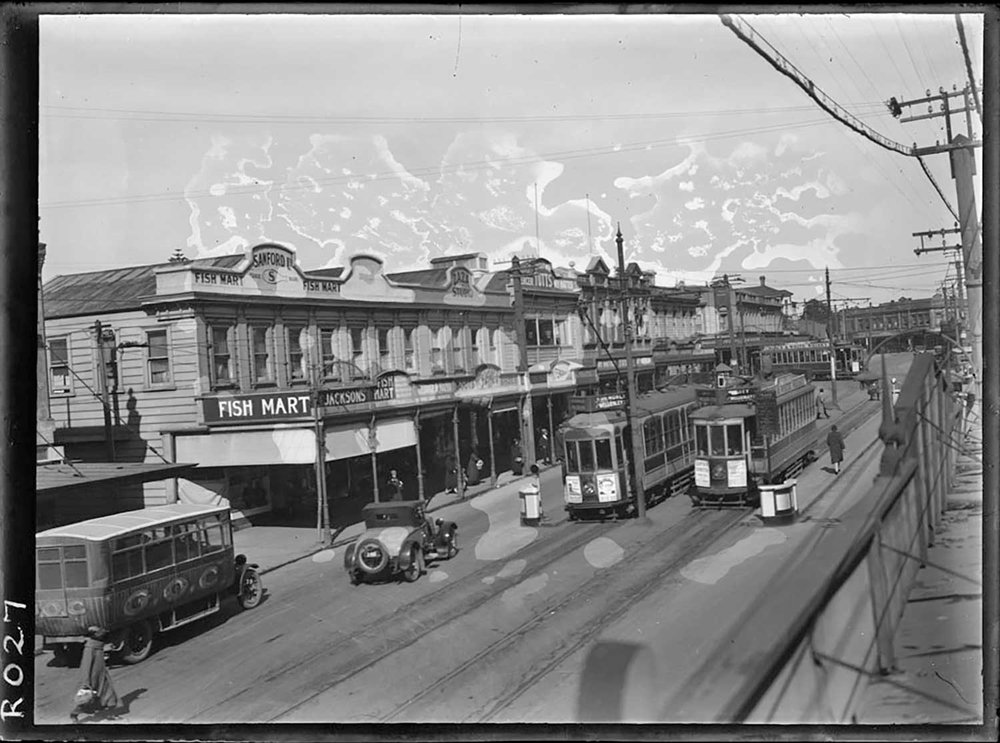 1925: Looking along Upper Symonds Street, showing trams and a bus running past the premises of Sanford Fish Mart (Photo: Sir George Grey Special Collections, Auckland Libraries, 35-R27)