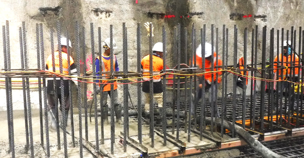 Construction workers pour concrete for base slab of tunnel below the Chief Post Office Auckland 8 January 2019