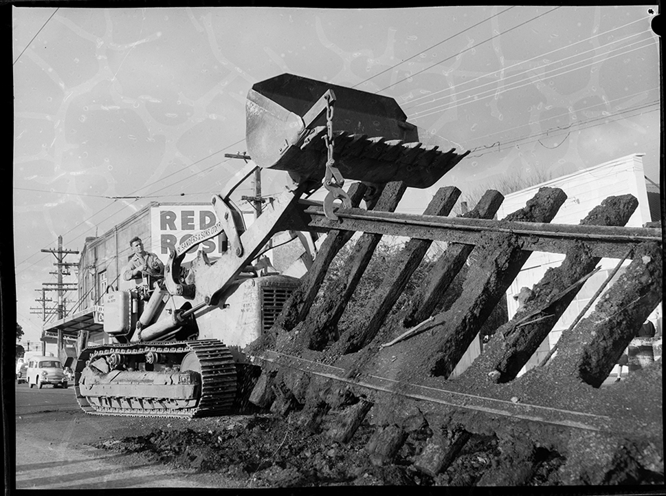 TRACKS: Tram tracks being removed in New North Road near the rail overbridge at Rocky Nook, Malvern Road in June 1960 (Photo: Sir George Grey Special Collections, Auckland Libraries, 1370-658-14)
