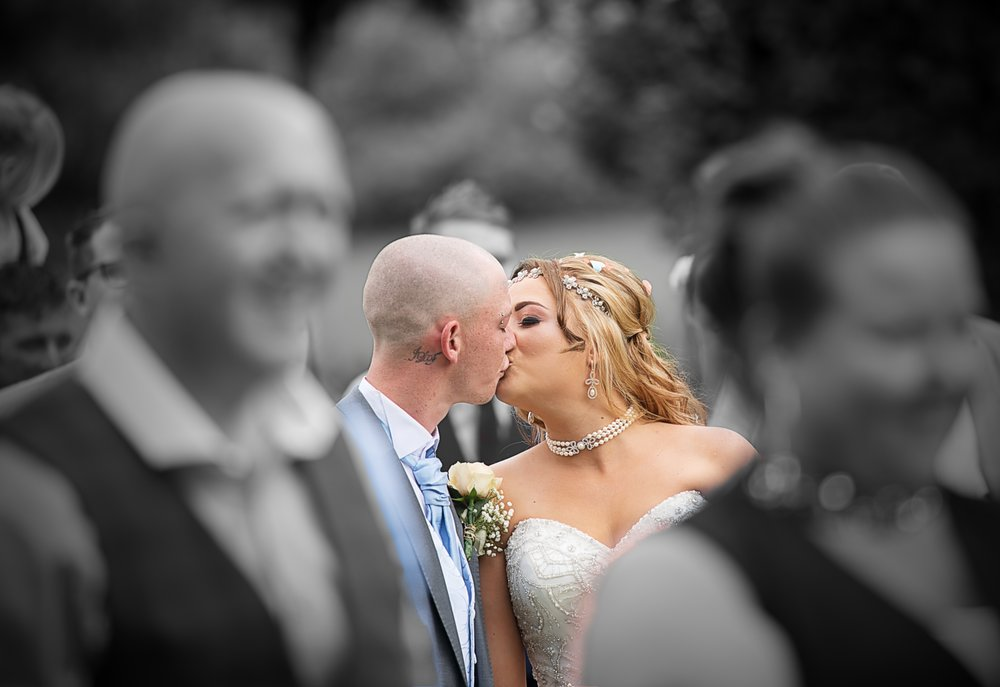 newly weds kissing - colour pop - candid shot - mansfield manor - nottingham wedding photographer