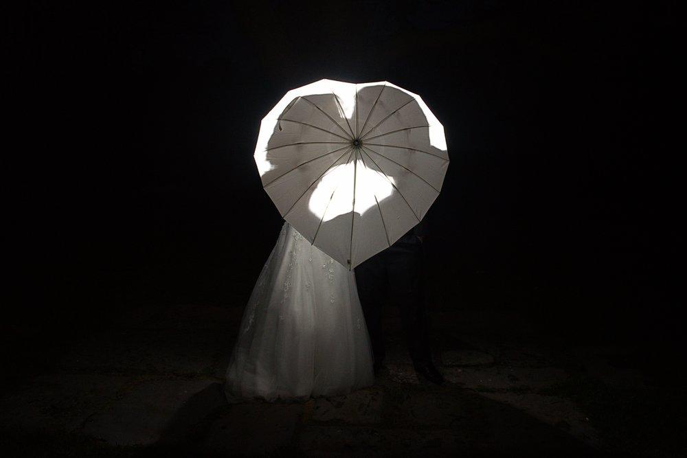 Kissing behind the umbrella.jpg