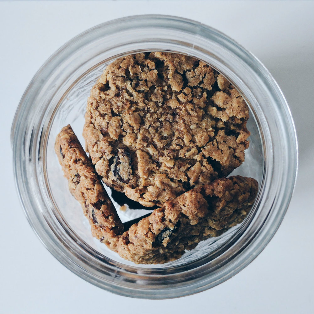 Oatmeal cookies with raisins and dried cranberries. Looking down the cookie jar.