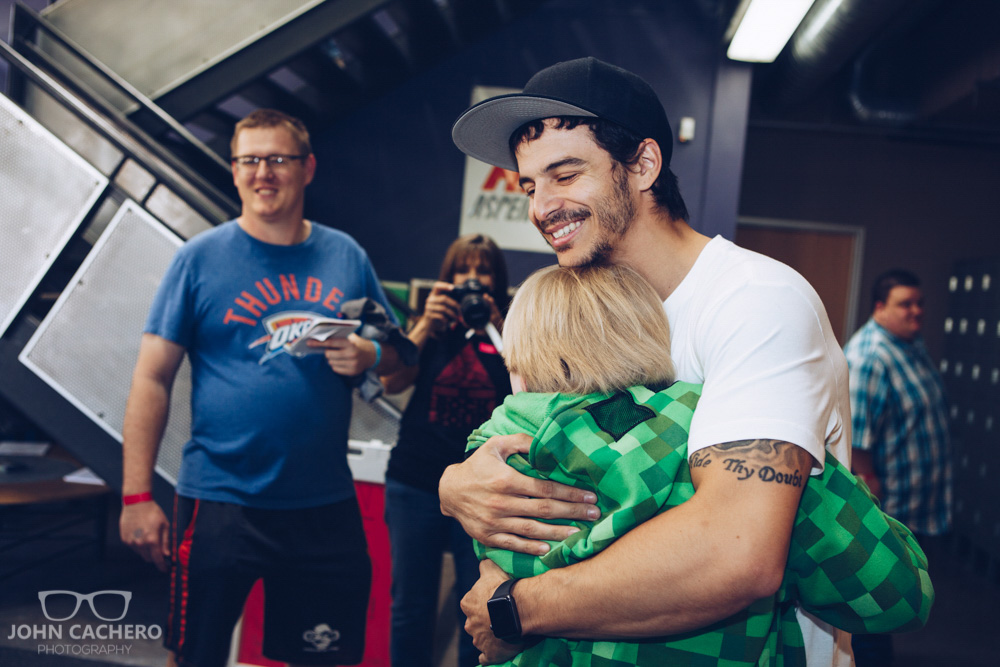 Ninja warrior, Flip Rodriguez, hugging it out with a fan.
