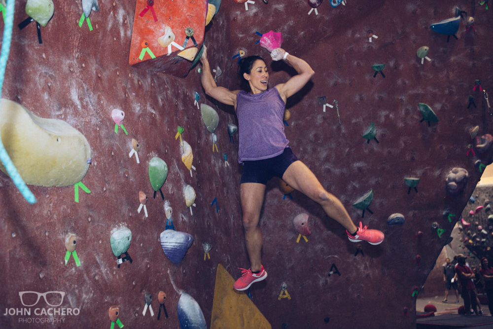 Ninja warrior, Tammy McClure, finishing her course run on the wall.