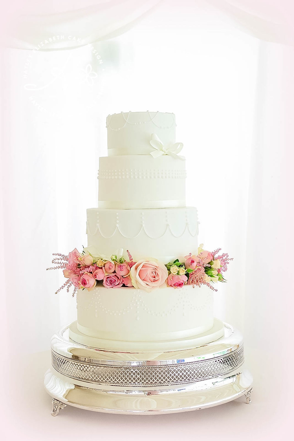 all-white-weddingcake-with-fresh-flowers.jpg