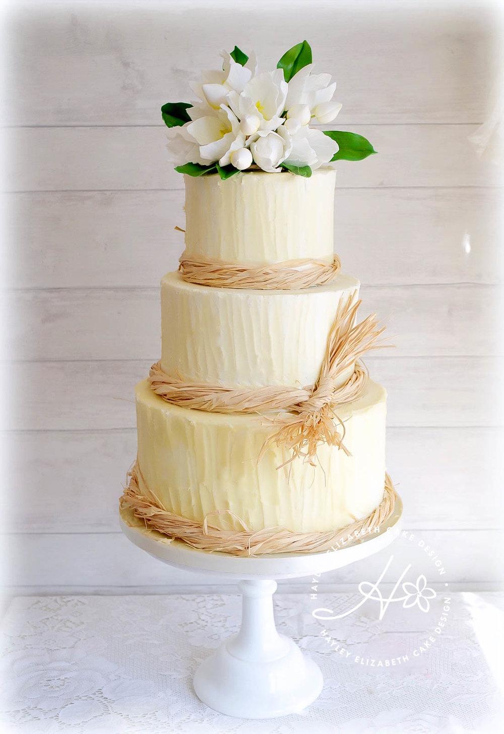 buttercream rustic  wedding cake with tulips.jpg