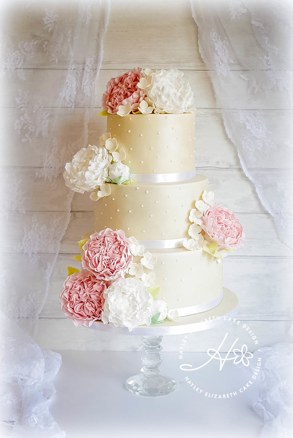 cream-dotty-cake-with-sugar-peonies.jpg