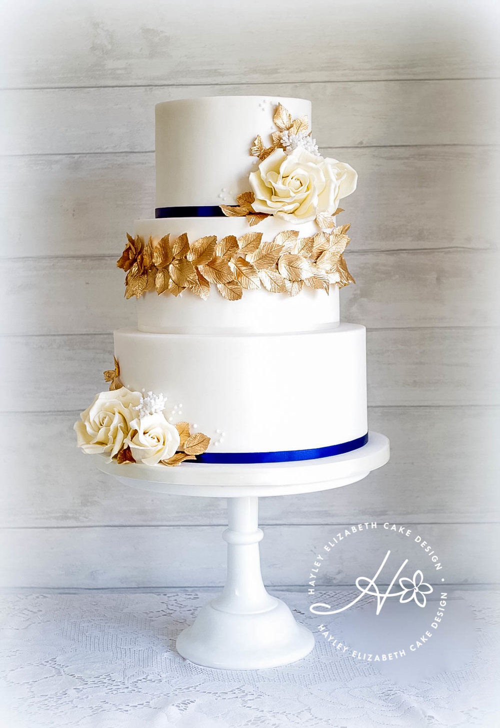 ivory-rose-and-gold-leaves-wedding-cake.jpg
