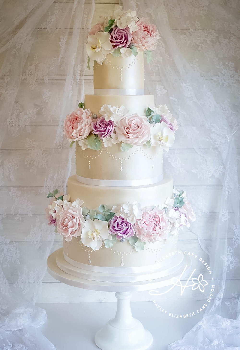 ivory-shimmer-wedding-cake-withroses-and-orchids.jpg