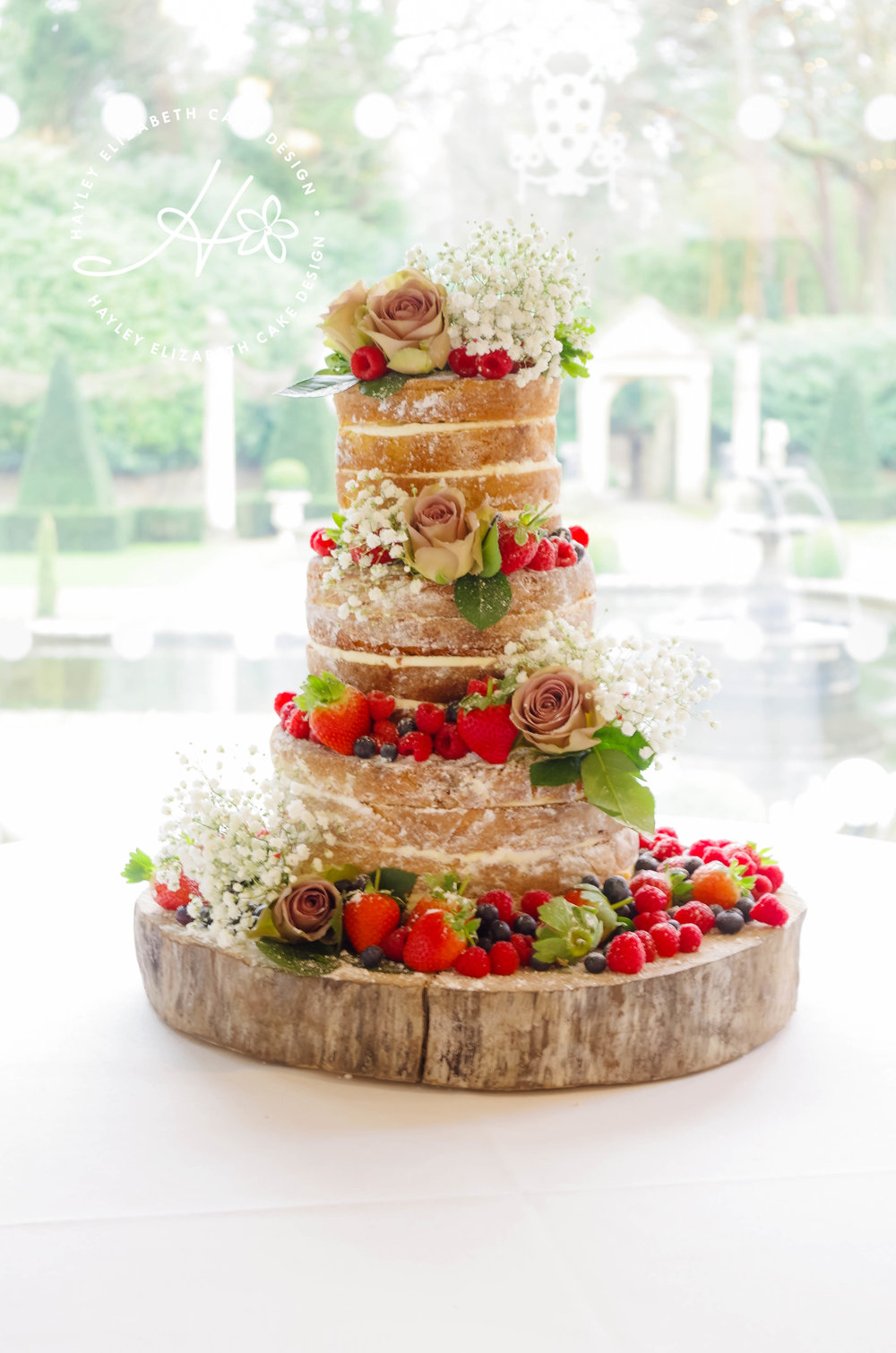 naked wedding cake with frsh fruit.jpg