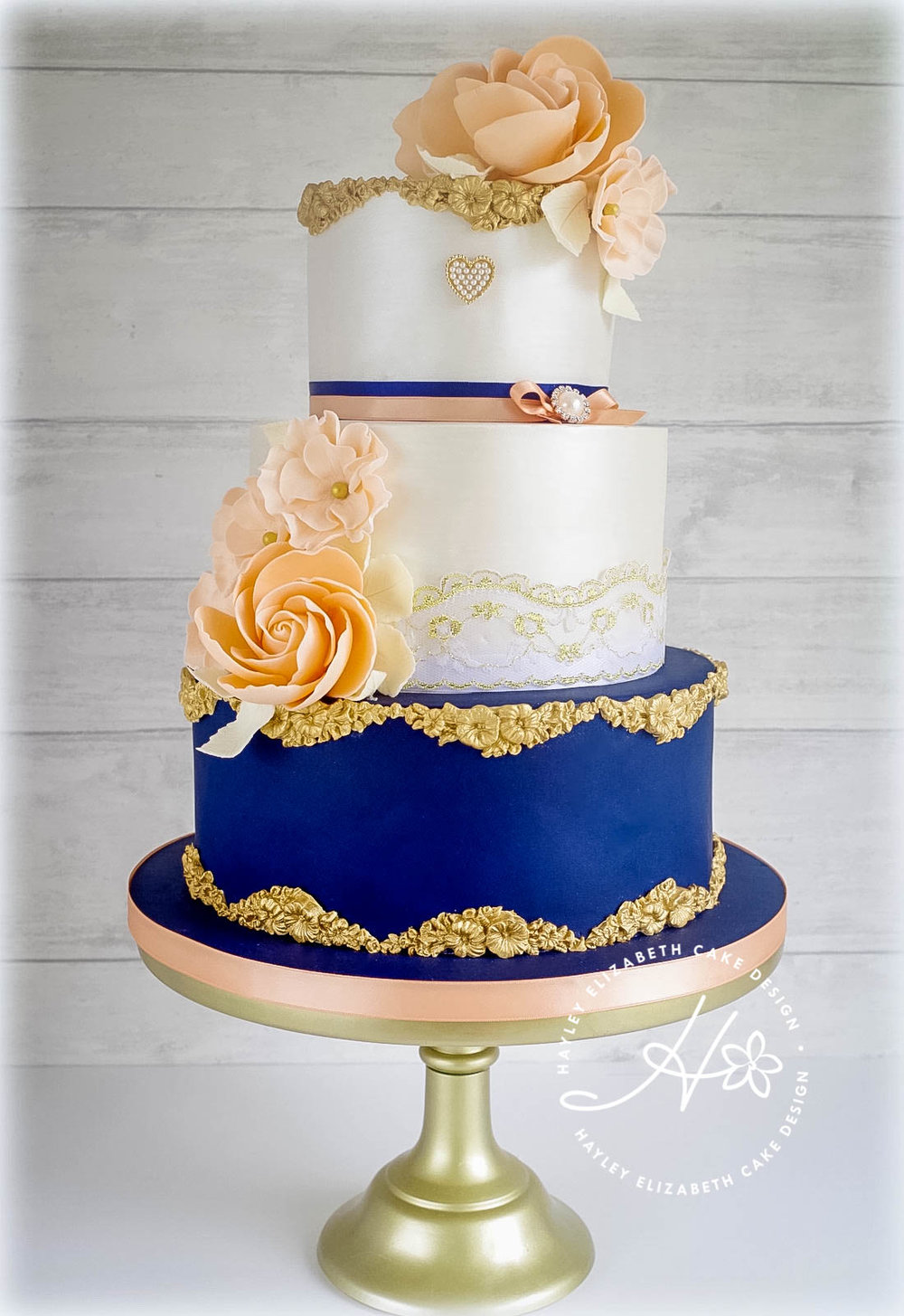 navy-and-gold-wedding-cake-peach-flowers.jpg