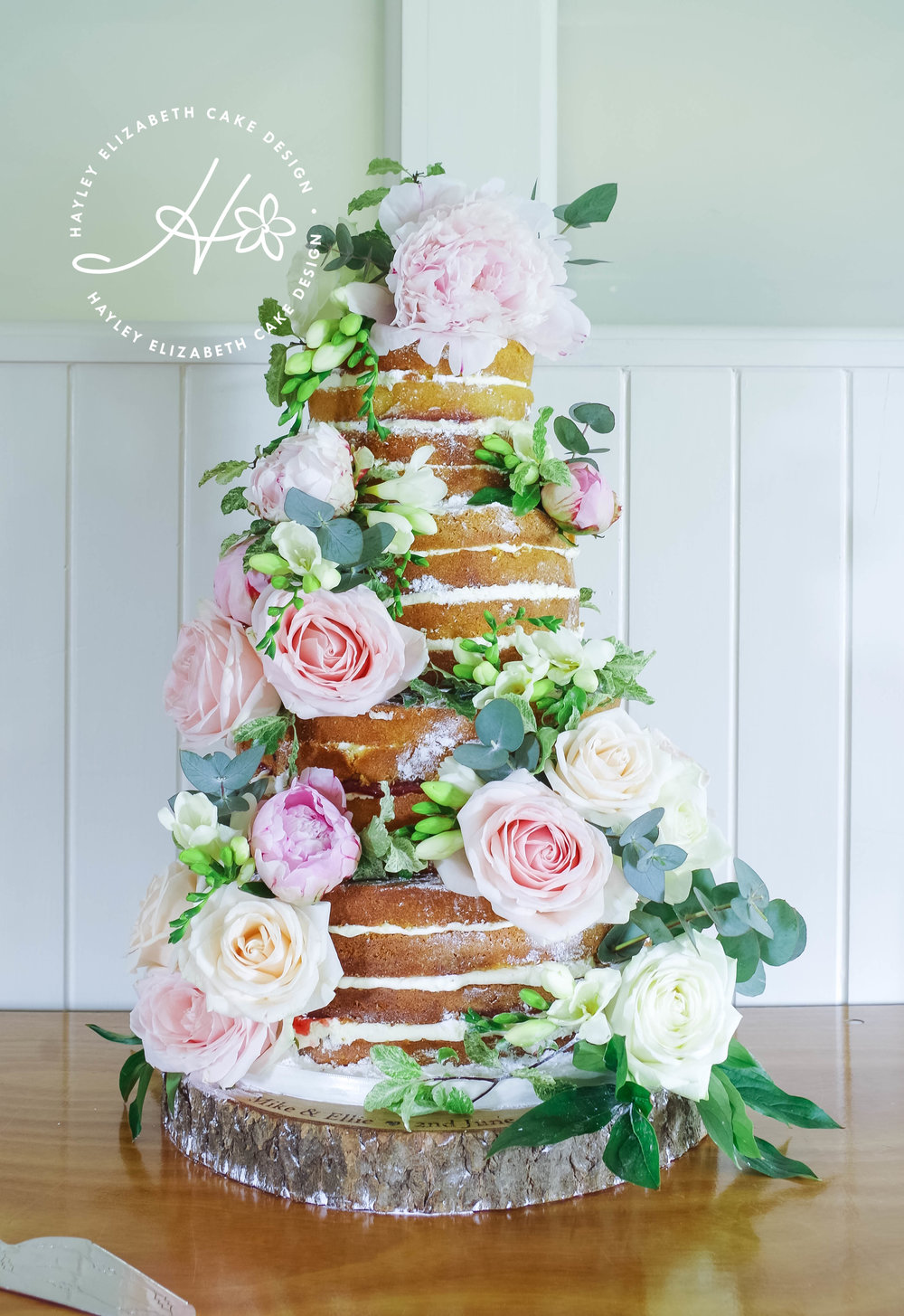 naked-wedding-cake-withfresh-flowers.jpg