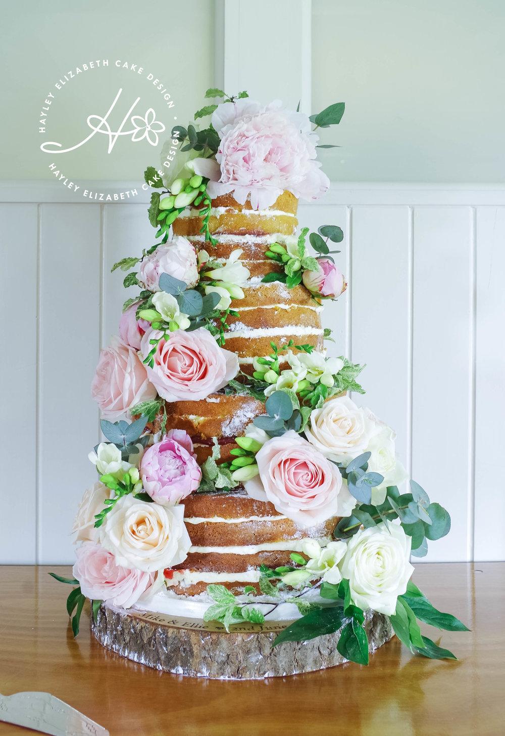 naked-wedding-cake-withfresh-flowers.jpg