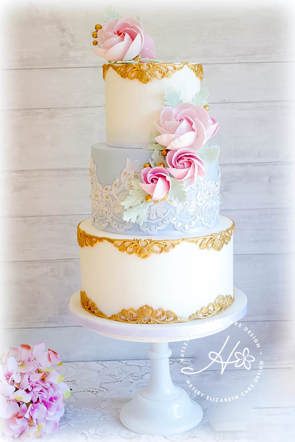 pastel-blue-and-white-wedding-cake-withgold-trim.jpg