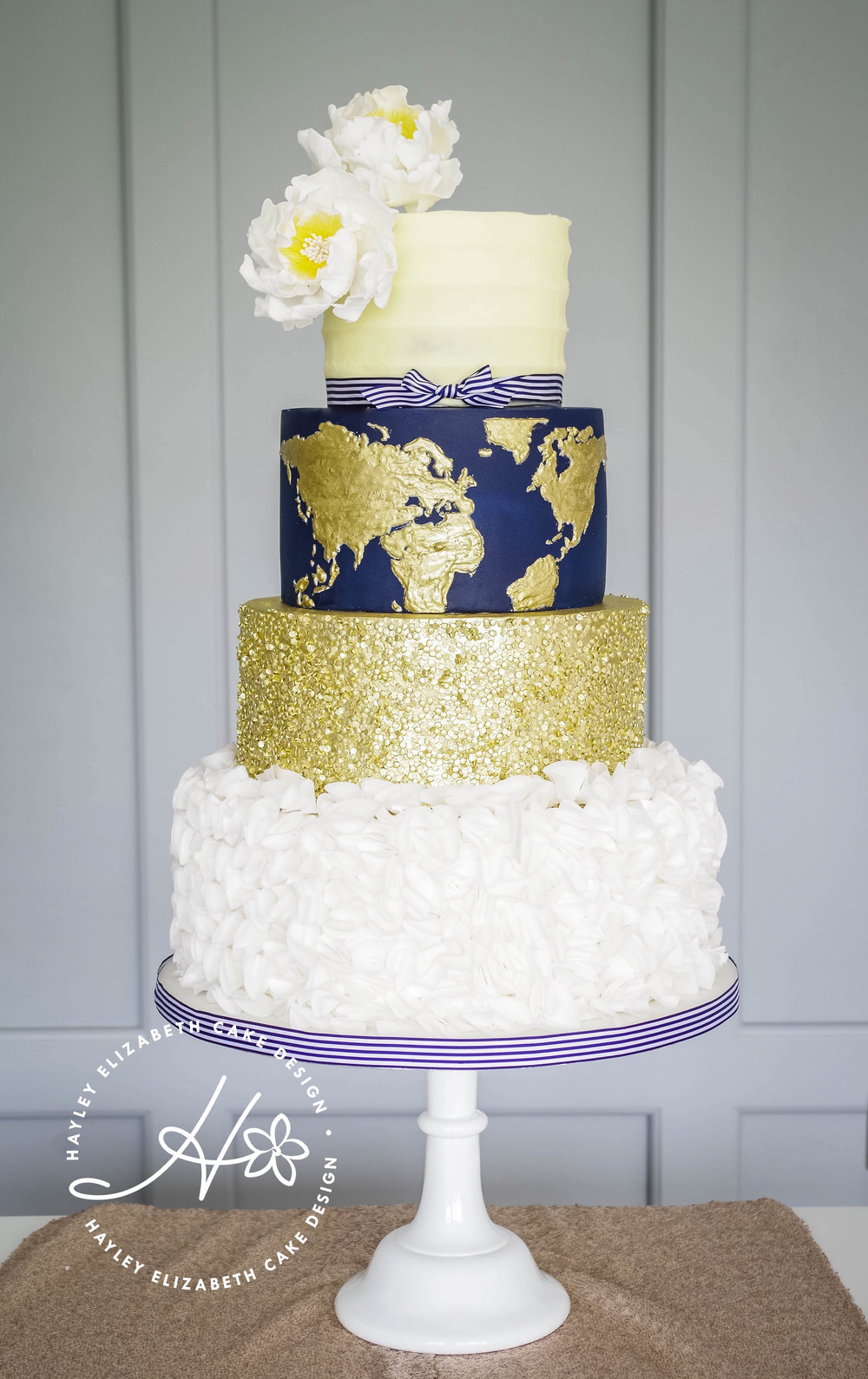 navy-gold-wedding-cake-with-world-map-detail.jpg